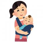 抱っこ紐を使って赤ちゃんを抱っこするお母さん