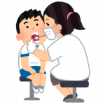 子供が歯科で検査してもらっている