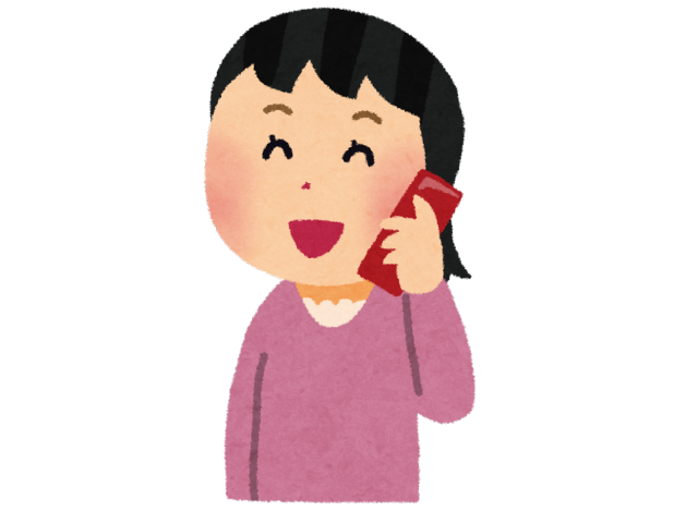 携帯電話で話す親